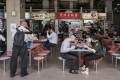 Restrictions on dining will be reimposed after Singapore's latest cluster of coronavirus infections. Photo: EPA