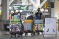 Travellers at Vancouver International Airport in Richmond, British Columbia, Canada, on July 5. Photo: Xinhua