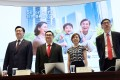 Banking officials at a Silver Bonds press conference on June 29, when it was announced that the age range was being lowered. Photo: K. Y. Cheng