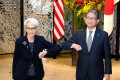 US Deputy Secretary of State Wendy Sherman, on a Asian tour, bumps elbows with Japan's Vice-Minister for Foreign Affairs Takeo Mori before their meeting in Tokyo on Tuesday. Photo: AFP