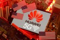 The US flag and a smartphone with the Huawei and 5G network logo are seen on a PC motherboard on January 29, 2020. Photo: Reuters