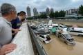 Zhengzhou residents survey the aftermath of the floods on Wednesday. Photo: STR/AFP