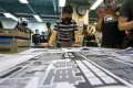 Apple Daily executive editor-in-chief Lam Man-chung prepares the newspaper's final edition last month. Photo: Dickson Lee