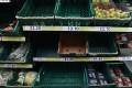 Half-empty shelves at a supermarket in London. Photo: EPA-EFE