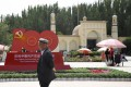 Photo taken July 3, 2021 shows a man walking near A monument commemorating the 100th anniversary of the founding of the Chinese Communist Party is seen in Kashgar, Xinjiang Uyghur Autonomous Region. Photo: Kyodo
