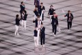 The Taiwanese team led by flag bearers Lu Yen-hsun and Kuo Hsing-Chun enter the Olympic Stadium in Tokyo during the opening ceremony. Photo: Reuters