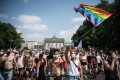 Participants take part in the annual Christopher Street Day parade with the motto 'Save Our Community- Save Your Pride' in front of Brandenburg Gate in Berlin, Germany on Saturday. Photo: AFP