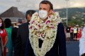 France's President Emmanuel Macron is welcomed on the tarmac upon his arrival at Faa'a international airport in Tahiti, French Polynesia. Photo: AFP