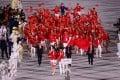 Flag bearers Zhao Shuai and Ting Zhu lead the China contingent during the athletes' parade at the opening ceremony of the Tokyo Olympics on Friday. Photo: Reuters
