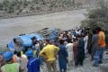 Rescuers and onlookers gather around the wreck of a bus in Pakistan which plunged into a ravine on July 14 following an explosion, killing 13, nine of whom were Chinese workers. Photo: AFP
