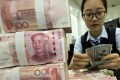 The Global Public Investor survey, published annually by the London-based OMFIF think tank, showed 30 per cent of central banks plan to increase their reserve holdings of yuan over the next 12-24 months, compared with just 10 per cent last year. Photo: AP