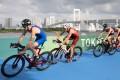 Hong Kong's Oscar Coggins leads Switzerland's Andrea Salvisberg in the bike leg of the men's triathlon at the Tokyo Olympics on Monday. Photo: EPA-EFE