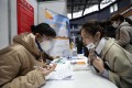 A jobseeker (right) being interviewed at a career fair in Wuhan, in China's central Hubei province, on March 10. China's tech giants are looking to hire thousands of new graduates this year and next amid increasing political pressure on the industry. Photo: AFP