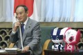 Japanese Prime Minister Yoshihide Suga speaks on the phone with judo gold medallist Naohisa Takato on Sunday. Suga's approval rating is at the lowest point since he took office last September. Photo: Kyodo