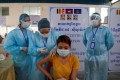 A garment factory worker receives a dose of Sinovac's Covid-19 vaccine at an industrial park in Phnom Penh earlier this year. Photo: Reuters