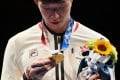 Hong Kong's Cheung Ka Long looks his gold medal for the men's individual foil during the Tokyo 2020 Olympic Games, on July 26, 2021. Photo: AFP