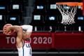 USA's Keldon Johnson goes for a dunk. Photo: AFP
