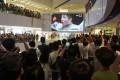Crowds gather at Hong Kong's AMP shopping centre to watch Edgar Cheung making history. Photo: Winson Wong