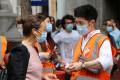 People queue for coronavirus vaccine shots in London's Chinatown on Monday. Photo: Hilary Clarke