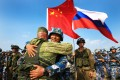 Chinese and Russian marines hug during a joint naval drill in China's Guangdong province in 2016. The two nations say their troops will stage an exercise together in Ningxia in August. Photo: Xinhua