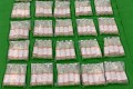 Bottles of liquid ketamine found hidden inside a shipment of rose water airmailed to Hong Kong from Pakistan. Photo: Handout