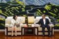 Teresa Cheng meets Supreme People's Court president Zhou Qiang in Beijing. Photo: SCMP Pictures
