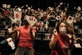 Fans cheer after Japan clinched the softball gold medal at the Tokyo Olympics on July 27. Photo: AFP