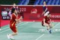 Japan's Yuta Watanabe and Arisa Higashino react after beating Hong Kong's Tse Ying-suet and Tang Chun-man in the bronze medal match of the badminton mixed doubles at the Tokyo Olympics. Photo: Kyodo