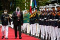 US Defence Secretary Lloyd Austin walks past military honour guards in Manila on Friday. Photo: AFP
