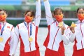 China's women's quadruple sculls team of Chen Yunxia, Zhang Ling, Lyu Yang and Cui Xiaotong celebrate with their gold medals. Photo: Reuters