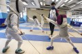 Phones have been very busy at Hong Kong's fencing schools since Edgar Cheung's gold medal performance. Photo: Felix Wong