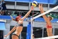 Switzerland's Anouk Verge-Depre (left) attempts a shot past Canada's Sarah Pavan in their beach volleyball contest at the Tokyo Olympics. Photo: AFP