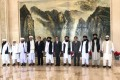 The Taliban delegation with Chinese Foreign Minister Wang Yi in Tianjin. Photo: Handout