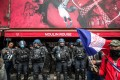 French anti-riot forces stand guard in front of the Moulin Rouge during a protest against the coronavirus health pass in Paris, France on Saturday. Photo: EPA-EFE