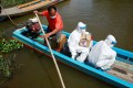 Health workers travel by boat to bring Covid-19 swab tests to rural residents near Bangkok. Photo: Reuters