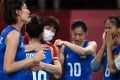 China head coach Lang Ping hugs her players after the team's win over Argentina. Photo: Xinhua