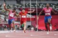 Su Bingtian of China crosses the 100m finish line behind US sprinters Ronnie Baker and Fred Kerley, at the Olympic Stadium in Tokyo on August 1. Photo: Reuters