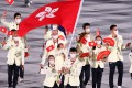 Flag bearers Cheung Ka Long and Tse Ying Suet of Hong Kong lead their contingent during the athletes' parade at the Tokyo Olympic Games opening ceremony. Photo: Reuters