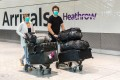 Passengers arrive at London's Heathrow Airport on Monday. Photo: EPA-EFE