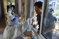 A resident gets tested in Nanjing on Monday as the country grapples with its most widespread outbreak in months. Photo: AFP