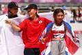 Japan's Kokona Hiraki (silver), Japan's Sakura Yosozumi (gold) and Britain's Sky Brown (bronze) celebrate their medals after the women's skateboarding park final at the Tokyo Olympics. Photo: Gettyimages