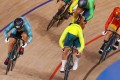 Sarah Lee Wai-sze (left) powers home to win heat two of the women's keirin repechage at the Izu Velodrome in Japan. Photo: Getty Images