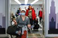 Travellers arrive at the international terminal of O'Hare Airport in Chicago in March last year. Photo: AFP