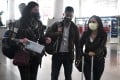 Wall Street Journal reporters (from left) Julie Wernau, Stu Woo and Stephanie Yang departing Beijing in March last year. They were among a number of reporters from three major US newspapers forced to leave China. Photo: AFP
