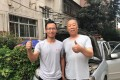 Ye Jungang, (left) was viciously trolled online after travelling to offer help during Henan province's recent floods. Photo: Handout