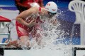Canada's Maggie MacNeil likes to splash herself with pool water before racing. Photo: Reuters