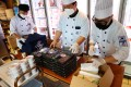Chefs dispatched from South Korea prepare boxed meals for the country's Tokyo 2020 Olympic Games delegation at a hotel in Japan rented out for their sole use. Photo: Reuters