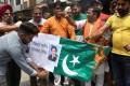 Indian activistsburn Pakistan's flag. Photo: AFP