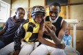 Jockeys watching their race on a mobile phone at the Ngong racecourse in Nairobi, on October 21, 2018. Photo: EPA-EFE.