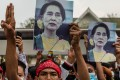 People protest against the military coup in Myanmar. More than 900 people are believed to have been killed and thousands arrested in the military's crackdown on dissent this year. Photo: DPA